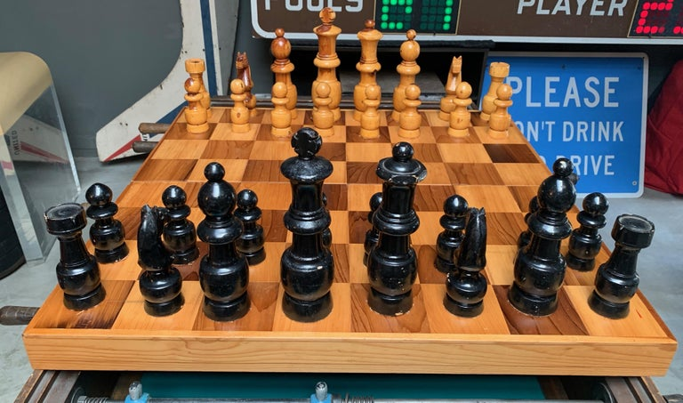 Massive oversized wood chess set. Box unfolds into chess board. Board newly cleaned. Great vintage condition.  For reference, size of King is 10