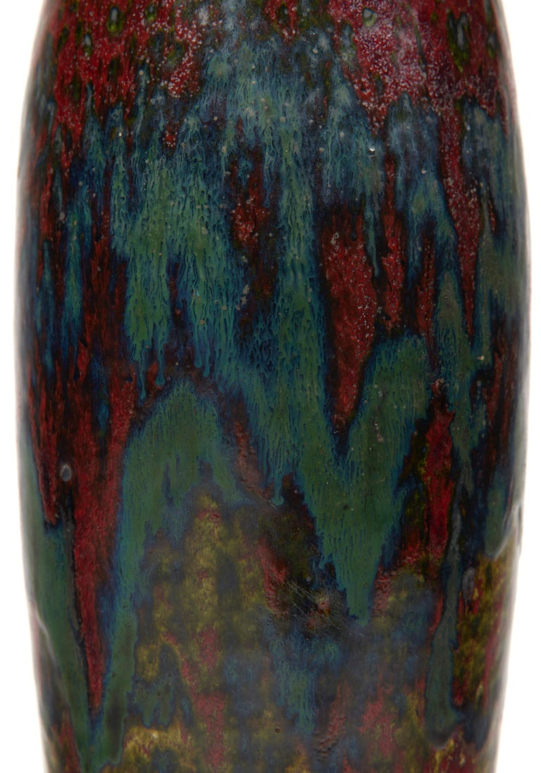Ovoid stoneware vase with hemmed neck, oxblood red, green and blue enamel.  Signature of a stamp in hollow