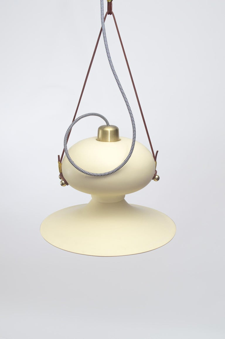 Ovoide n.° 3 is a hanging light, the result of the geometric and material exploration found in ACOOCOORO's signature lighting pieces, combining and playing with the voluminous and the soft, the futuristic and the nostalgic. The resin pendant hangs