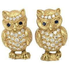 Eulen Manschettenknöpfe 18 Karat Gelbgold mit Diamanten und Blauen Saphiren