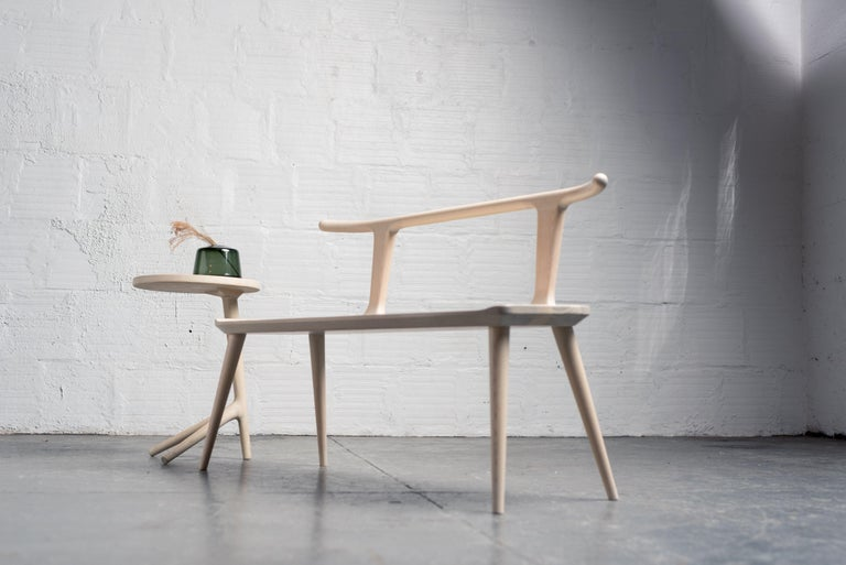 This entryway bench, designed by Justin Nelson for Fernweh Woodworking, evolved out of the Oxbend dining chair, leading also to a matching bar stool. The Oxbend Collection was born from a desire to create seating that is comfortable, organic, and