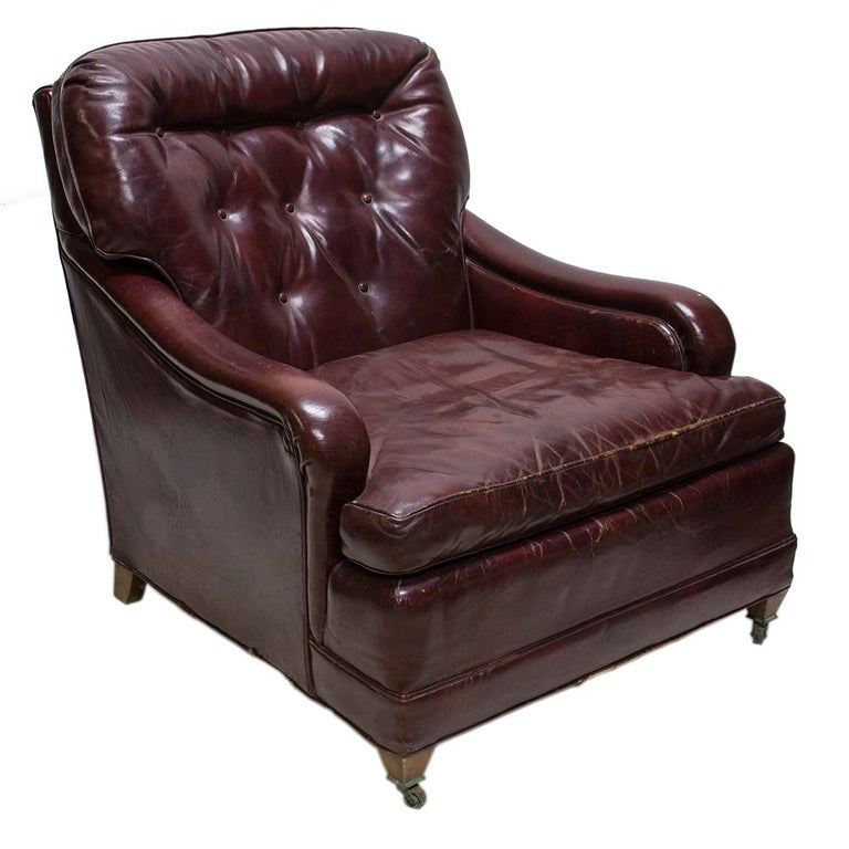This vintage leather club chair has character and style. The Chesterfield style tufted back cushion is a nice accent to the gently sloping arms and Classic boxy form.