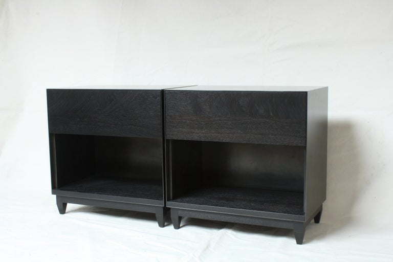Handmade in Chicago by Laylo Studio, these customizable nightstands or bedside tables feature a blackened steel case and a solid wood interior, drawer front and base. The thin front edge of the seamless metal case frames a drawer front and