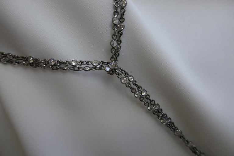 This necklace allows you to wear it in various ways. Its fun and light and can be layered with other pieces. The chain is oxidized silver 925 with cubic zirconia and finished with baroque cultured pearls. Extremely wearable item. This was designed
