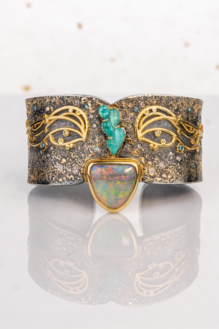 An oxidized sterling silver cuff bracelet with 18k yellow and white gold,  22k yellow gold