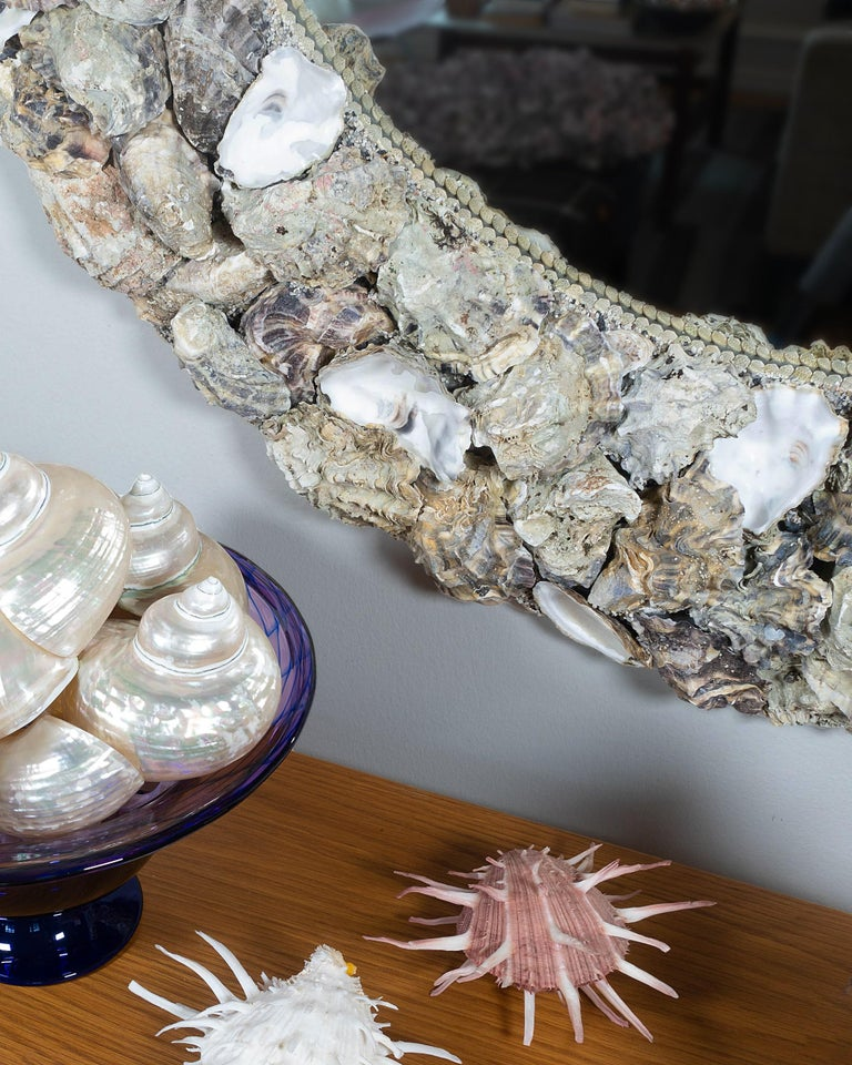 The Shellman oyster shell mirrors are among the most popular from shell artists Mikael and Buster. They manage to present edgy roughness and pure elegance at the same time. At first glance it may look beige only, but in an oyster shell you will find