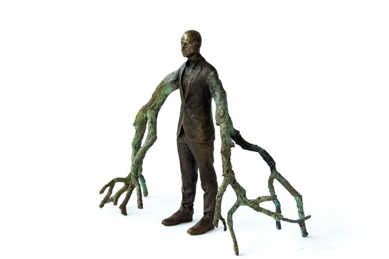 Canadian artist P. Roch Smith taps into a surrealist sensibility in the bronze sculpture of a suited man sprouting tree branches in place of arms.