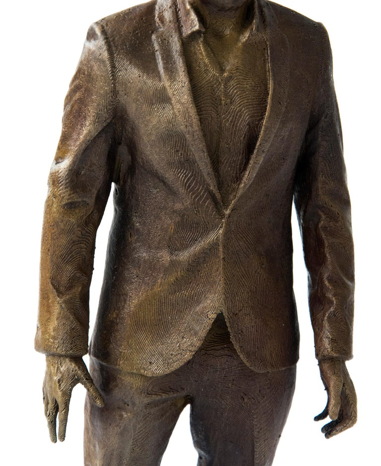 A suited man stands poised, staring intently in this intriguing psychological narrative in bronze by sculptor P. Roch Smith.Clues to the story may be found in the figure's contemporary dress, his lace up Italian shoes, posture and outstretched