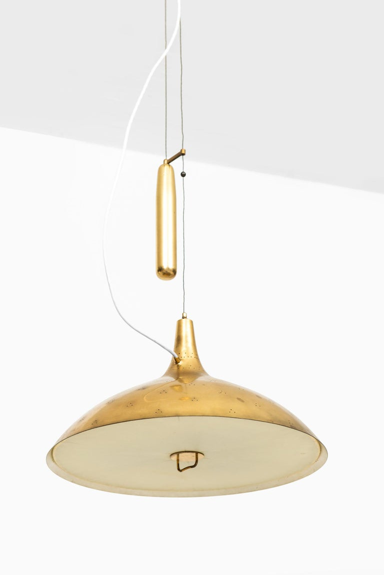 Rare ceiling lamp model A1965 designed by Paavo Tynell. Produced by Taito Oy in Finland. Measures: Height 105-160 cm.