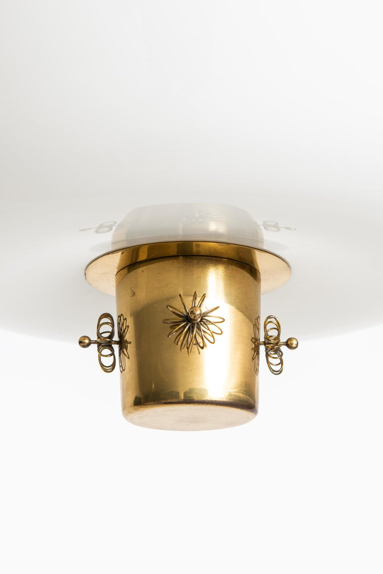 Rare ceiling lamp designed by Paavo Tynell. Produced by Taito in Finland.
