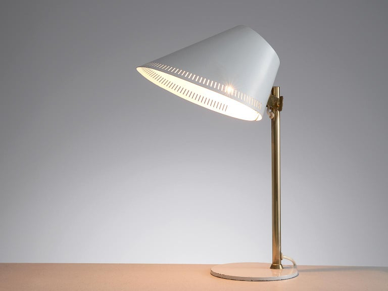 Paavo Tynell for Idman, desk light, white enameled metal and brass, Finland, 1950s.  Beautiful designed '9227' table lamp by Finnish designer Paavo Tynell for Idman. This model features a very refined design that shows Tynell's style perfectly.
