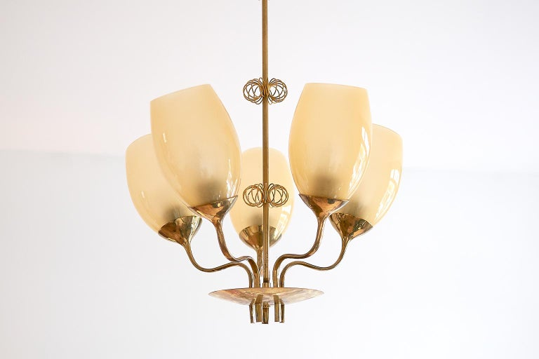 This five-glass chandelier was designed by Paavo Tynell and produced by Taito Oy in Finland in 1949. Paavo Tynell was responsible for designing the lighting for the hospital in Kuopio, which can be viewed in the sketches from the Taito archives (as