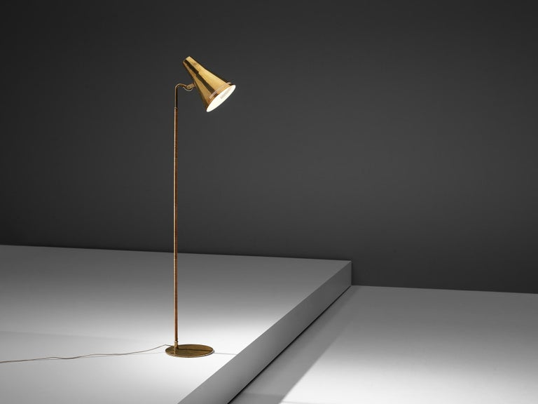 Paavo Tynell for Taito, model K10, floorlamp, lacquered metal, brass, cane, Finland, 1950s  Outstanding floor lamp, designed by Paavo Tynell, the Finnish design master of lighting. This delicate floor lamp has a few distinct features. The conical