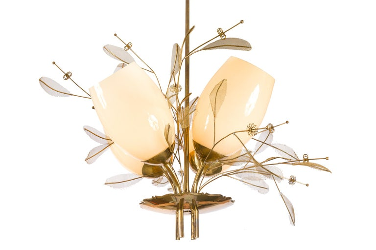 A Classic Tynell chandelier with the distinctive brass floral decoration. Paavo Viljo Tynell was a Finnish designer who is best known for his lighting fixtures and lamps. Among other things, Tynell designed the lighting for the office of the