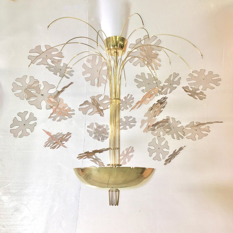 Original Model 10105/9041 Fantasia brass chandelier designed by Paavo Tynell and produced by Taito Oy Ab, Finland, 1950.  Purchased through The Finland House showroom, 39-41 East 50th Street, New York, NY. Pierced polished brass bowl with