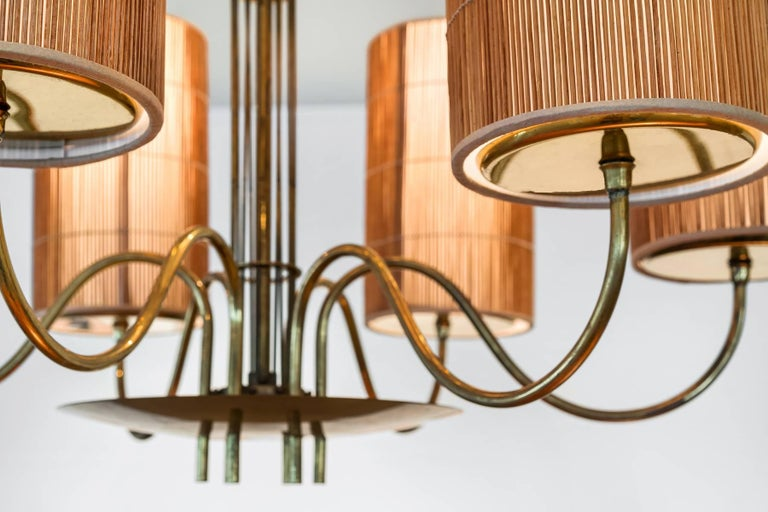 Paavo Tynell, Large Chandelier with Six Snowflakes, Brass, Reed, Taito OY, 1940s In Good Condition For Sale In West Palm Beach, FL