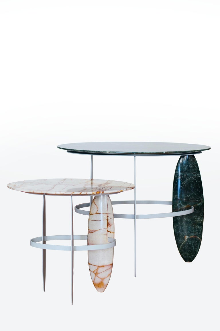 A set of sophisticated Brazilian semiprecious quartzite and pure quartz stone hand sculpted side table.  One table made with the rare Brazilian