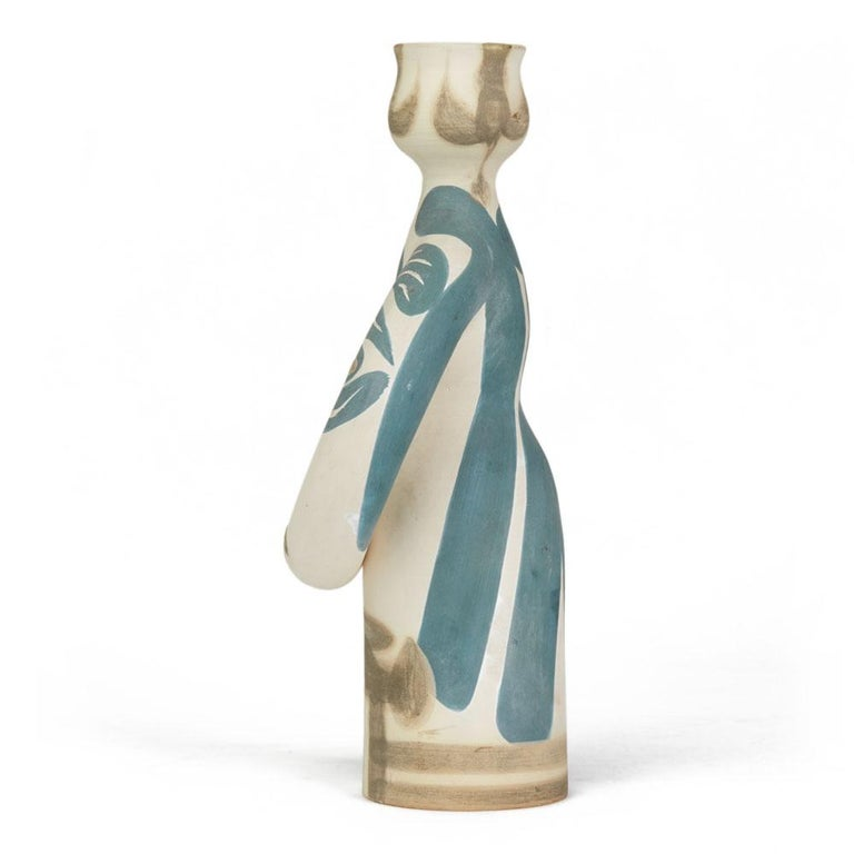 A Pablo Picasso (1881-1973) limited edition 'Lampe Femme' white earthenware vase of stylised female form with blue and brown partially glazed decoration. The vase has impressed Madoura Plein Feu/Edition Picasso marks to the base and has painted