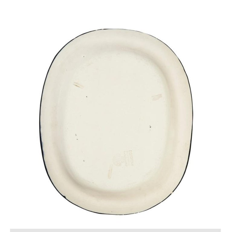 Picasso's 'Bouquet' plate is made of white earthenware clay, partially engraved, with colored engobe and glaze. It is stamped and marked 'Edition Picasso/Madoura Plein Feu/Empreinte Originale de Picasso' (underneath) This work was conceived in 1955