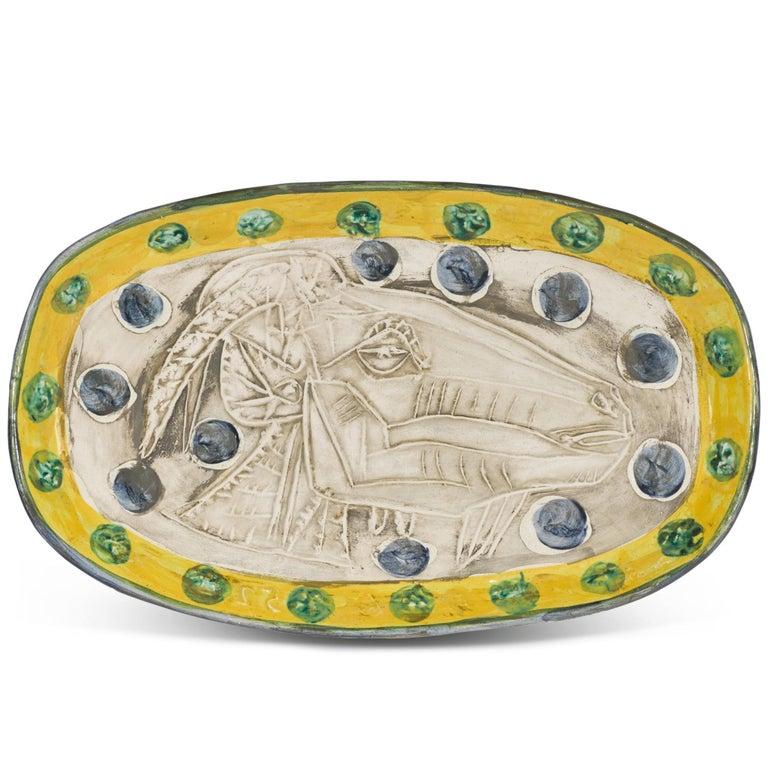 Pablo Picasso Madoura Ceramic Plate, 'Tête de chèvre de profil' Ramié 148 - Sculpture by Pablo Picasso