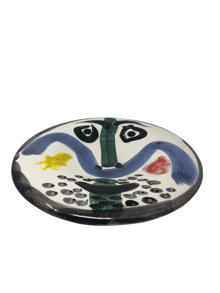 Pablo Picasso Madoura Ceramic Plate - Visage no. 130 , Ramié 479 - Abstract Impressionist Sculpture by Pablo Picasso