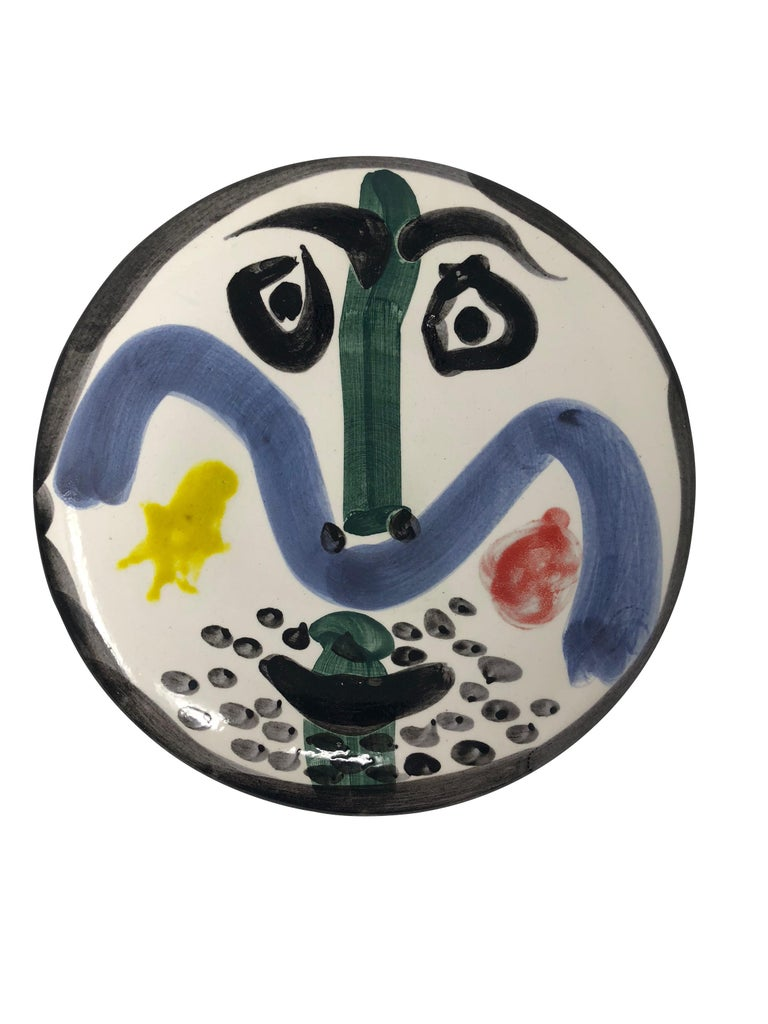 Pablo Picasso Madoura Ceramic Plate - Visage no. 130 , Ramié 479 - Sculpture by Pablo Picasso
