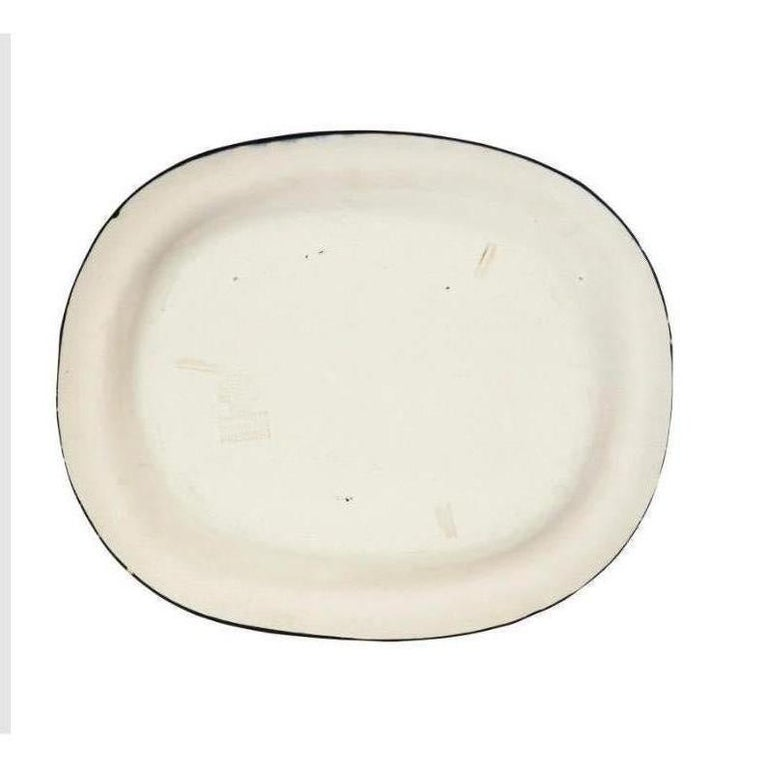 Picasso's 'Nature Morte' plate is made of white earthenware clay, partially engraved, with colored engobe and glaze. It is stamped and marked 'Edition Picasso/Madoura Plein Feu/Empreinte Originale de Picasso' (underneath) This work was conceived in