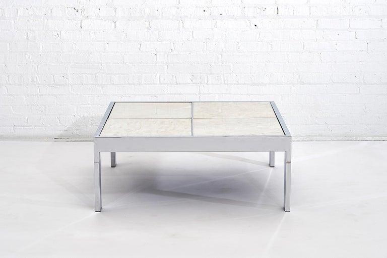 Chrome and white Carrera marble coffee table by Design Institute America, circa 1970.
