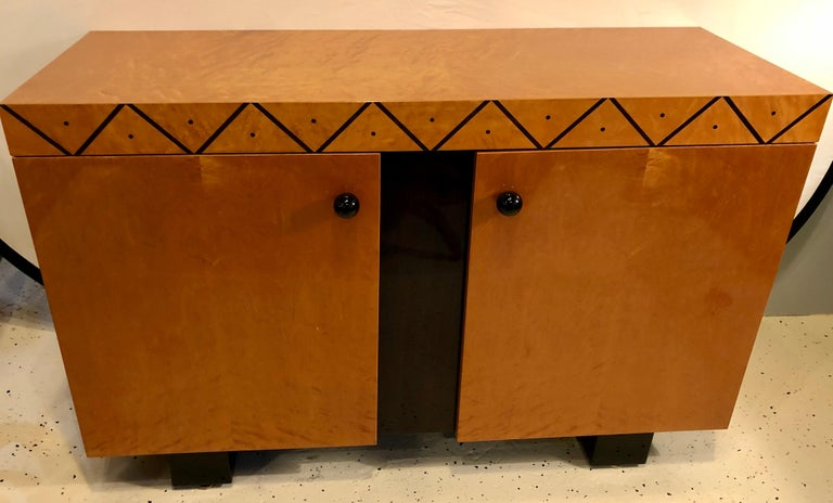 Pace collection modern lacquered server, cabinet, or console. Mid-Century Modern looking chest or serving cabinet in a high polished lacquered finish. The two-door cabinet leading to an ebony custom shelf area having an ebony designed front with