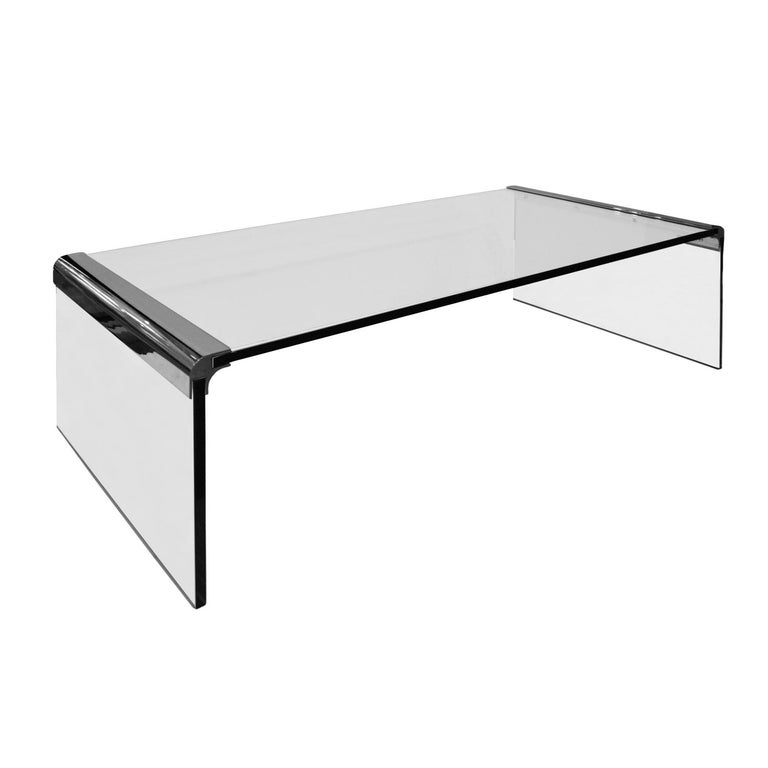 Clean-line waterfall coffee table in thick glass with polished chrome corners by Leon Rosen for Pace Collection, American, 1970s.
