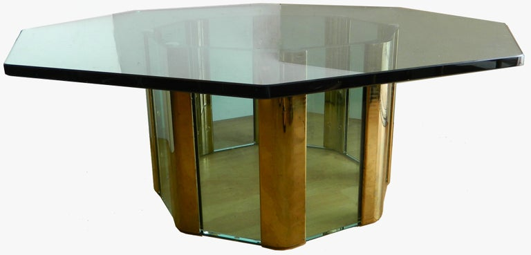 Mid-Century Modern huge very elegant and heavy cocktail table by Pace. Made out of Glass Panels with Brass. Comes with a heavy Octagonal Glass Top. Measurement: 22 inches diameter base.