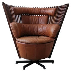 Pacific Green Tavarua Palm Wood and Leather Swivel Chair