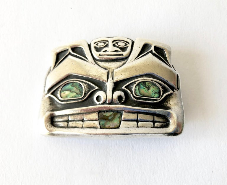 Native American Pacific northwest coast sterling silver mask money clip accented with abalone eyes and mouth.  Clip measures 1 3/8