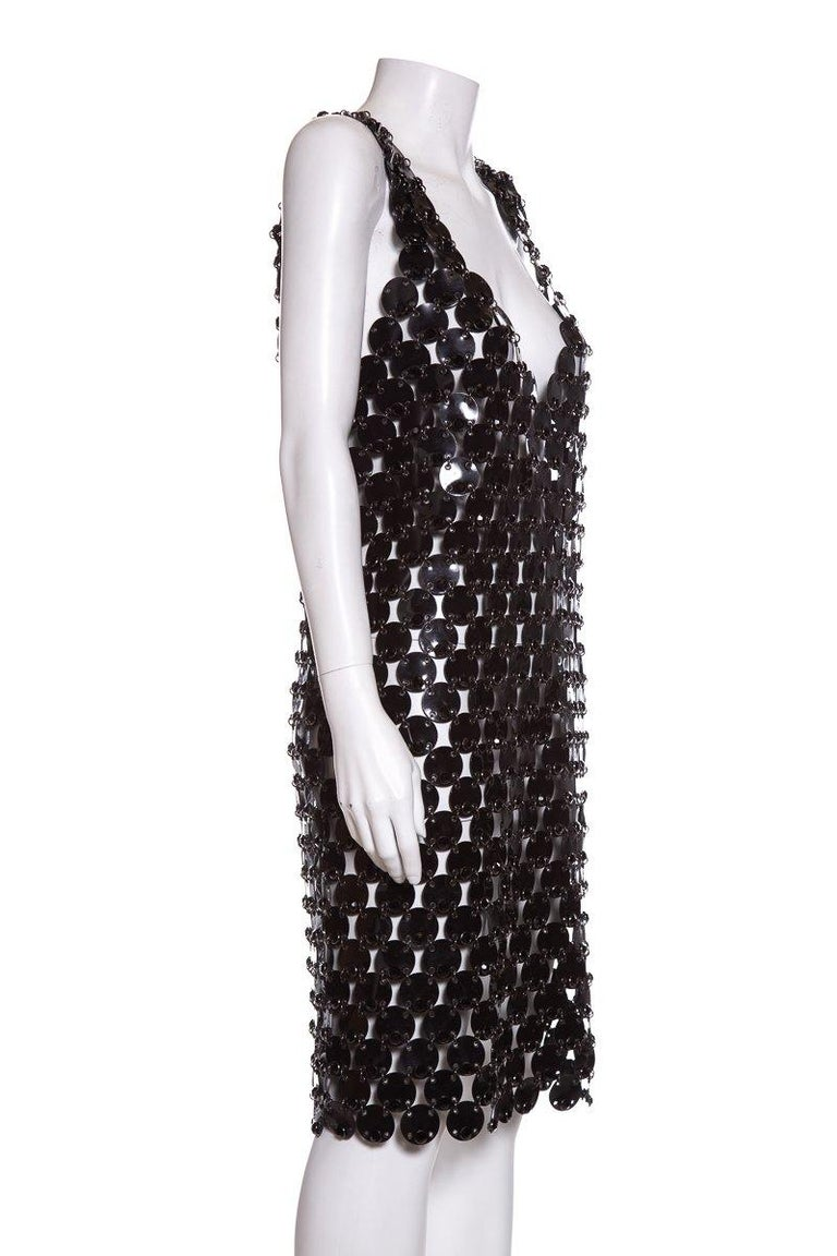 Paco Rabanne black sleeveless Rhodoid dress with deep V neckline, scalloped hem, and black crystal embellishments throughout.  This item is in very good condition with no signs of wear or imperfections.   Make origin and fabric information