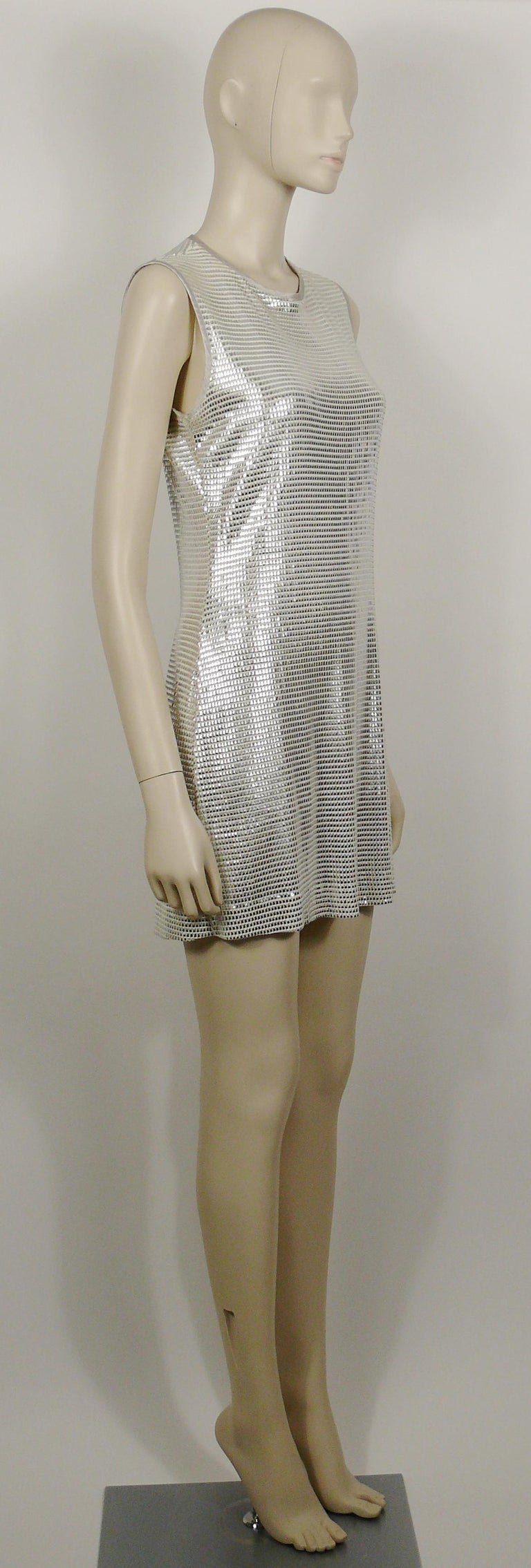 PACO RABANNE white mini dress with silver foil grid.  Top surface is silver foil printed creating a metallic chain mail effect on a white knit spandex base.  Slips on. Hook neck closure. Unlined.  Label reads PACO RABANNE Paris. Made in
