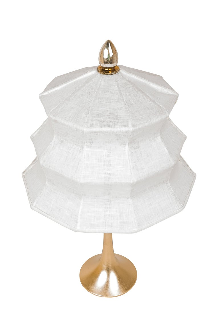 This table lamp is a contemporary piece, made entirely by hand in Tuscany Italy, 100% of Italian origin.   Inspired by the eastern Pagoda temple, Sabrina masterfully combines the geometric lines of the lampshade with the smooth, sinuous curve of the