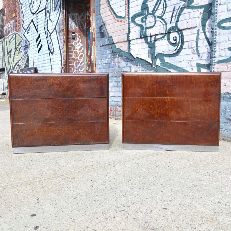Swanky set of burl wood dressers by Milo Baughman for Thayer Coggin. Each dresser features 3 drawers that operate smoothly. Both signed with maker tag inside top drawer. Brilliant colored wood with highly figured grains. Dressers rest upon