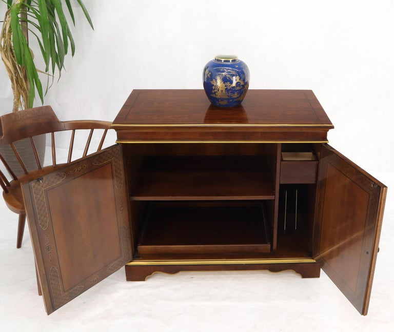 Double door chinoiserie style small credenza server cabinet by Drexel Heritage.