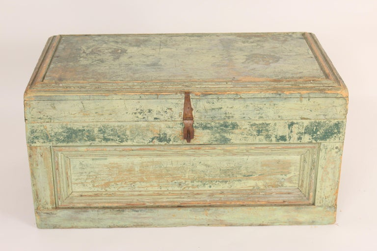 Trunk with old paint and iron hardware, late 19th century. Great for a coffee table or at the foot of a bed.