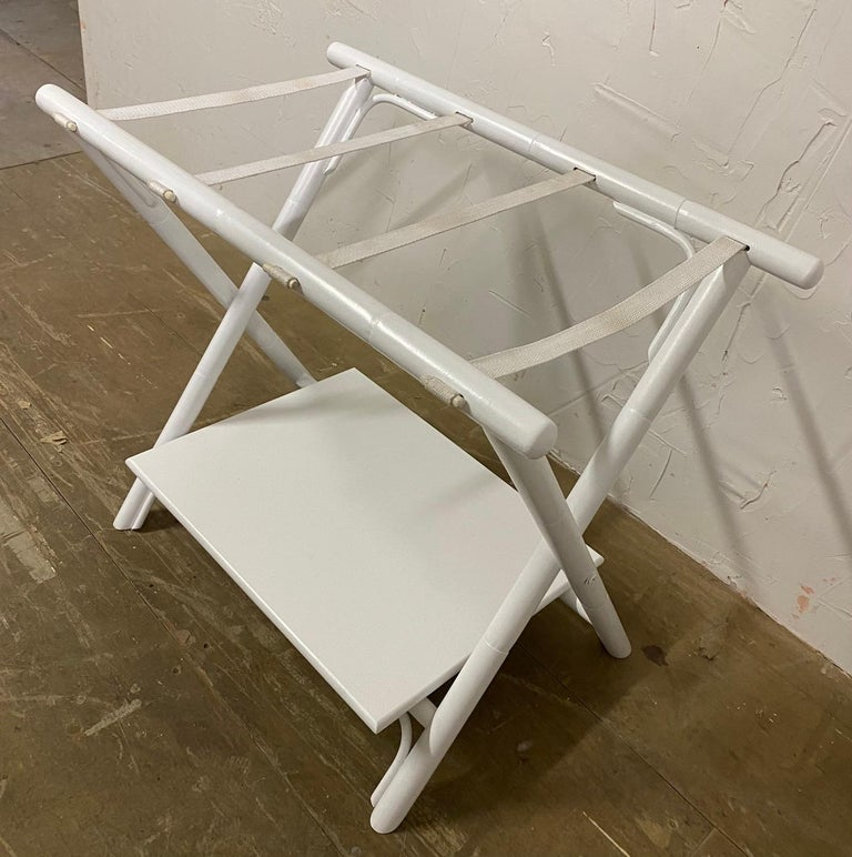 Folding faux bamboo luggage Stand with shelf. Folds for easy storage. Add a welcoming touch for overnight guests! Shelf is removed when folded. Painted in a gloss white. Measures: 24 H x 28 W x 17.5 D inches. Folded 3.5 x 28 x 29.5 H.