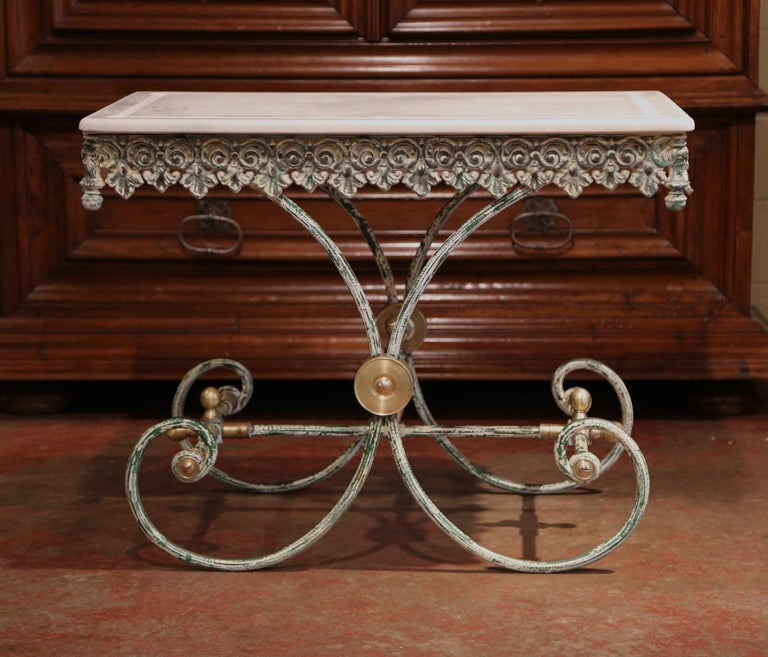 This French butcher table, or pastry table would add the ideal amount of surface space to any kitchen. Crafted in France, the iron work table has an antique green painted finished and features a scalloped apron with intricate metal work, beautiful