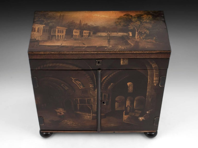 Impressive and very decorative papier mâché sewing cabinet painted with images taken from the book The Beauties of the Bosphorous, by Julia Pardoe, and illustrated by William Henry Bartlett, published in 1838. The top of the cabinet shows the