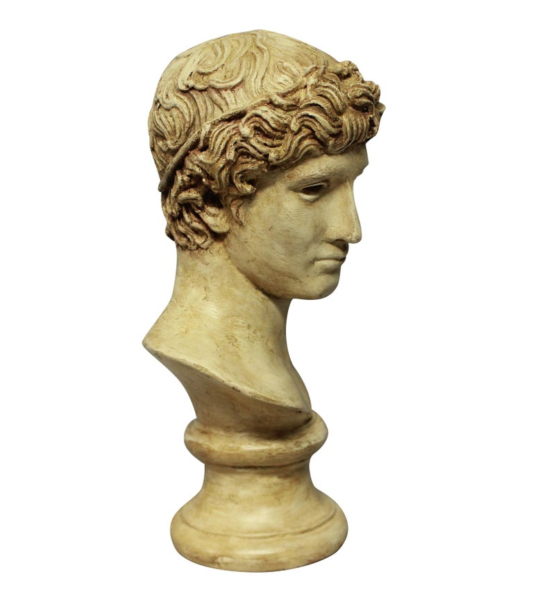 An English painted plaster head of a Roman youth.