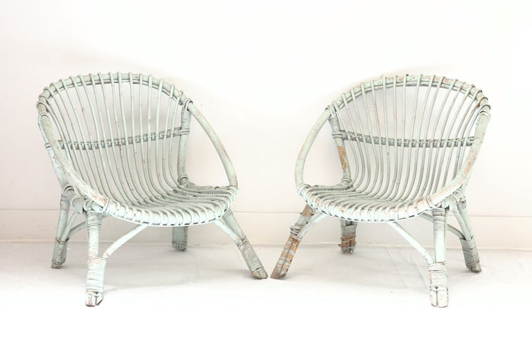 Pair of vintage mint green painted rattan armchairs.