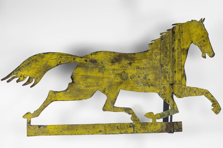Sheet iron Silhouette running horse weathervane with mustard paint.