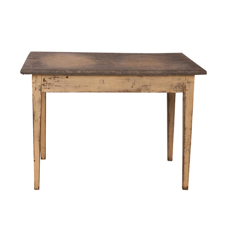 A 19th century French painted table with a zinc top, there is a small hole in the center of this table. Well used with and interesting patina.