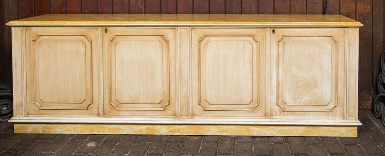 Large gold and yellow painted credenza with two bifold doors from France.