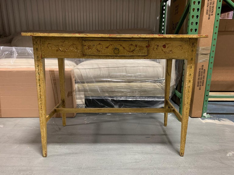 Painted yellow regency writing table with drawer, circa 1820.
