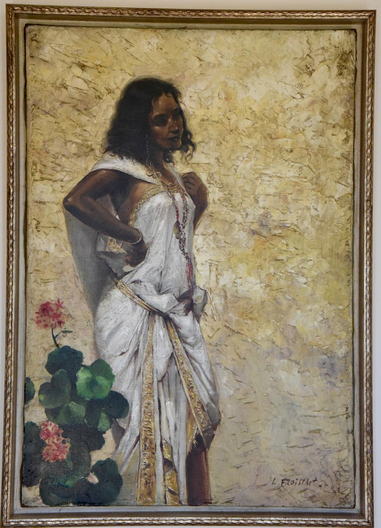 Art Nouveau oil painting of a woman in an Oriental dress leaning against a wall signed by L. Froissart. The artist used a palette knife to give structure to the ocher yellow wall, France, circa 1900. Framed.