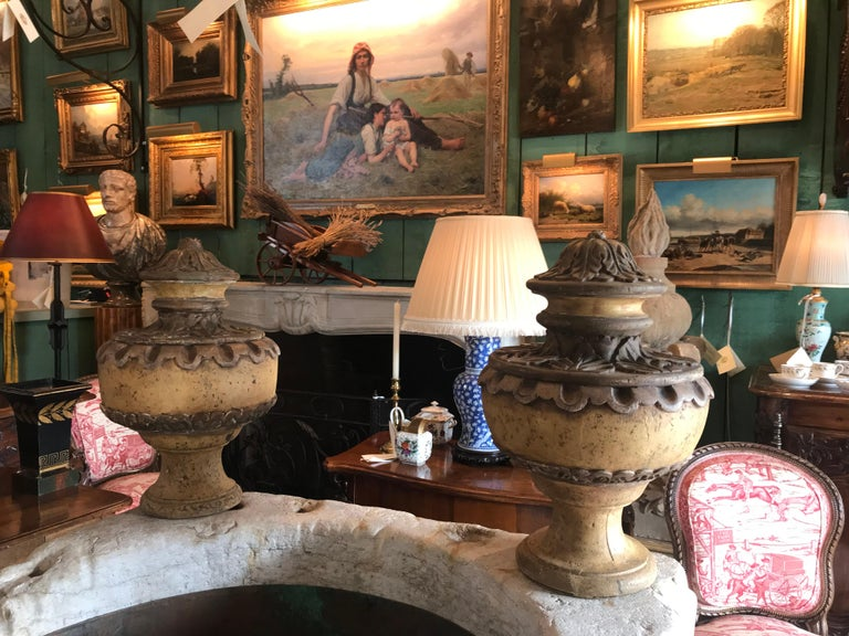 Beautiful late 18th century pair of Italian Baroque style carved wood finials urns. Worn distressed delicate carvings. This pair is very decorative and large wooden finials in the shape of urns resting on a round foot. The Baroque artists of the